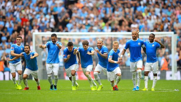 Los jugadores del City celebran el triunfo
