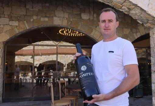 Winemaker Yaakov Berg displays a bottle of the wine named after the US Secretary of State.