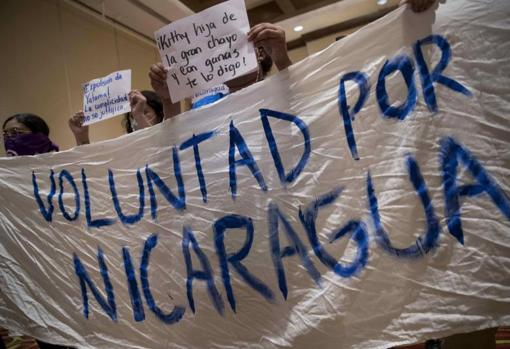 Young people protest in demand for unity of the political forces during a press conference this week in Managua