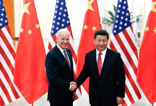 Joe Biden, in his time as US Vice President, greets Xi Jinping in Beijing